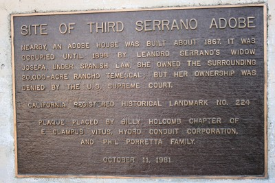 "This plaque notes the third adobe built by the Serrano family in about 1867 as being ""nearby."" Leandro Serrano died in the 1850s. It says Leandro's widow Josefa's ownership of the land was denied by the U.S. Supreme Court."