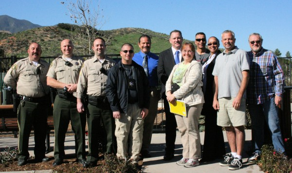Capt. Leonard Hollingsworth (back row, blue tie), and seven deputies from the Lake Elsinore Sheriff's Station, meet with Temescal Valley residents to discuss community concerns. Also pictured: Tracy Davis, Wildrose Ranch; Julian Gonzales, Sycamore Creek; Rob Mucha, The Retreat, and John Watson, Wildrose Ranch.