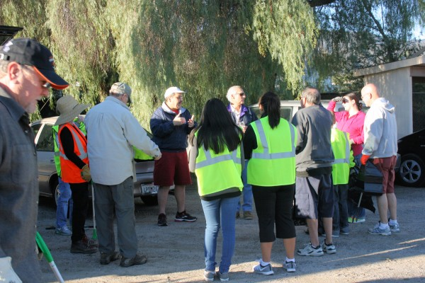 Beautification Chairman Bob Hafner (center) gives instructions to some of the volunteers before the cleanup begins.