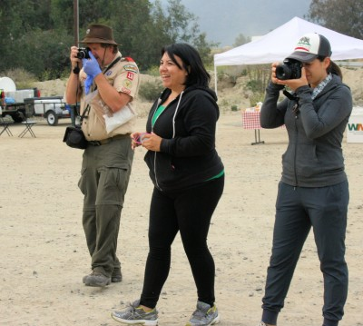 From left, Bill Peck, Boy Scout leader Troop 13; Lily Quiroa and Mariam Cardenas, Waste Management Inc., grab a photo op.