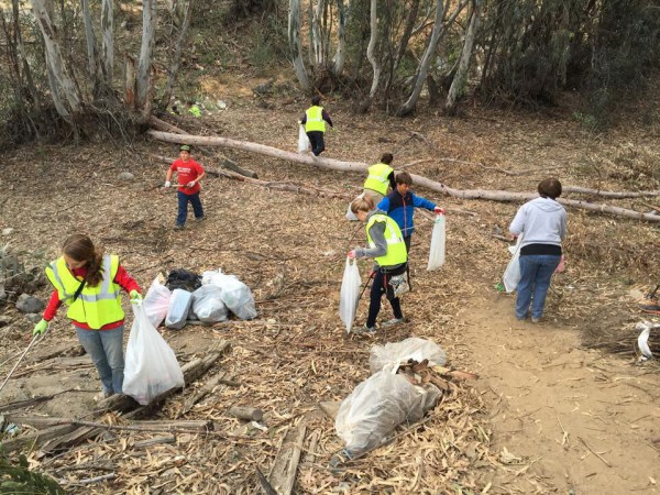 Half the volunteers spent their time removing trash and illegally dumped discards from the Temescal Wash.