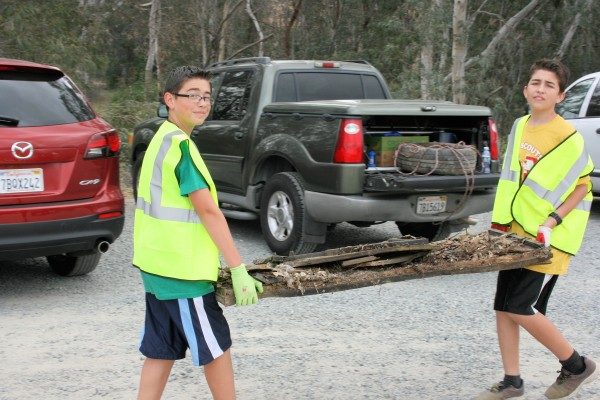 Troop 13 Scouts help clean the junk and trash from the Temescal Wash.