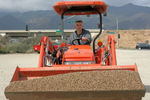 Spanish Hills resident Martin Lange and his front loader move a pile of gravel closer to the vats.