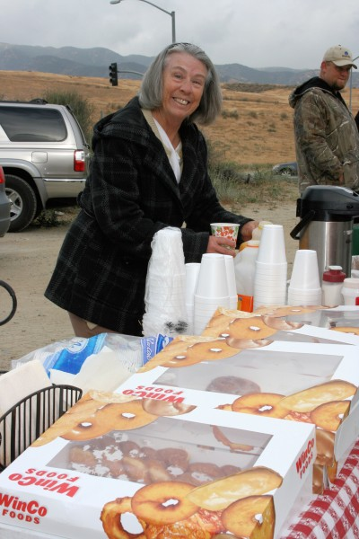 Helen McGlaughlin of Hot Diggidy Dog hands out doughnuts and beverages ant the beginning of the event.