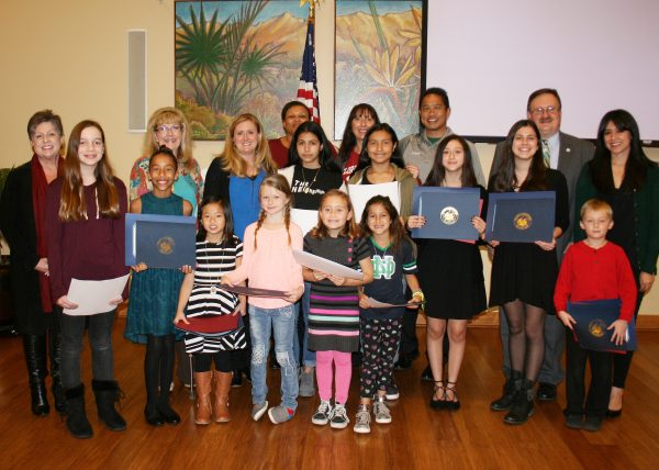CALENDAR ART CONTEST WINNERS: Students were honored at the January MAC meeting by teachers, principals and elected officials, including Supervisor Kevin Jeffries, far right, back row.
